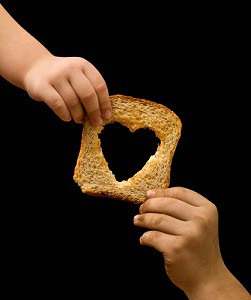 Passing a piece of toast.