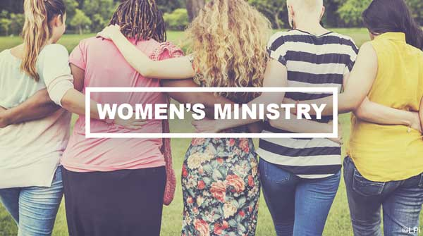women walking arm-in-arm with text 'women's ministry'