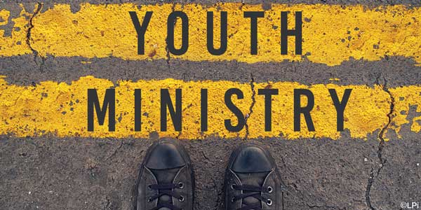 text 'Youth Ministry' written on yellow traffic lines
