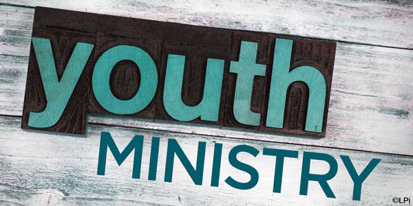 text 'Youth Ministry' on wood plank background