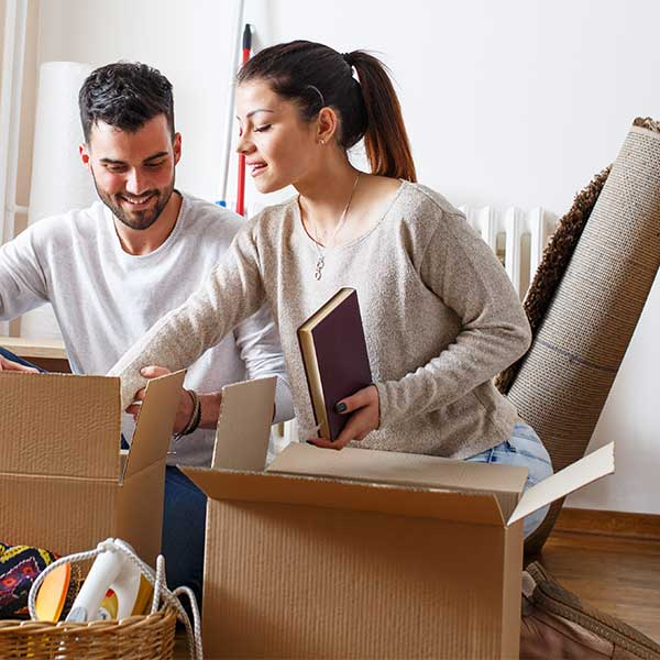 Man and woman unpacking boxes