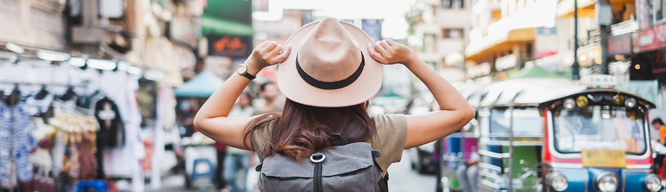 Woman traveler looking at foreign cityscape