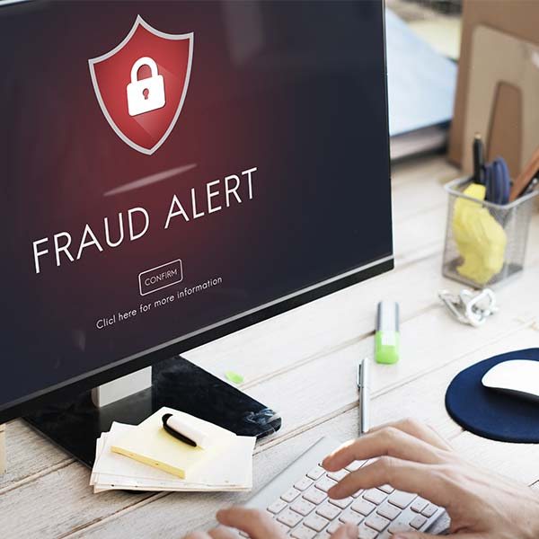 Fraud alert message pop-up on computer screen
