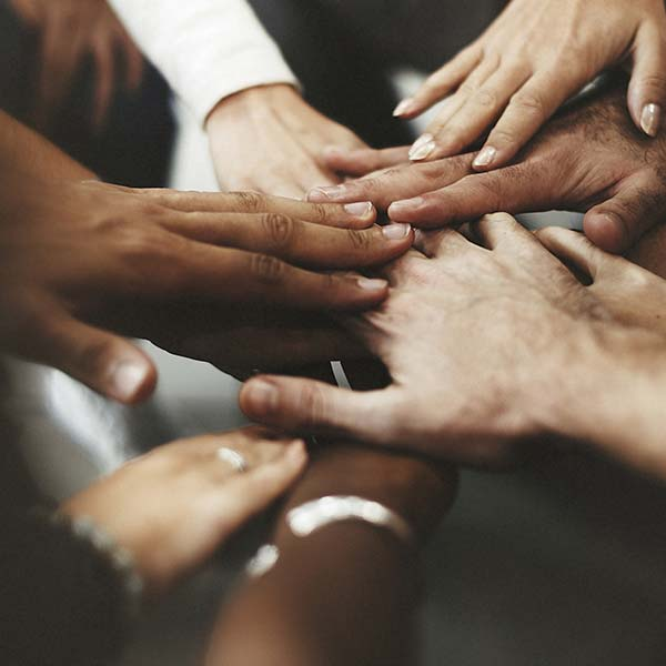 Hands huddled together in teamwork