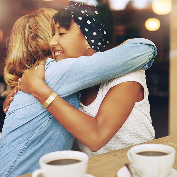Two women hugging in friendship