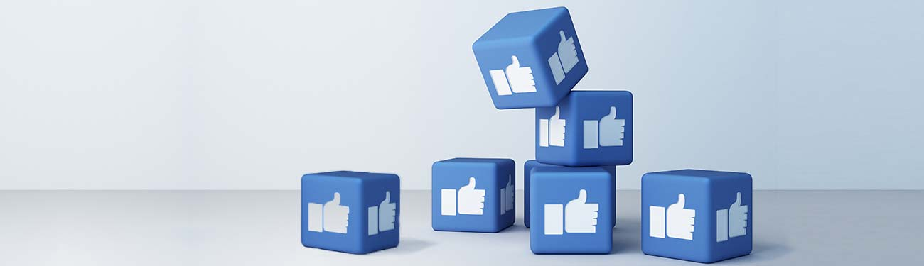Pile of blocks with Facebook social media 'Like' icon