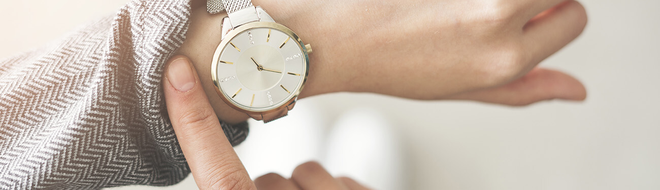 Women pointing at her watch